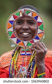 Nairobi/Kenya- March 14 . 2018 Year: Masai woman in ethnic african jewellery in Amboseli National park kenya