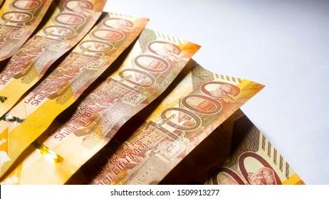 NAIROBI,KENYA-SEPTEMBER 18,2019: 1000 Kenya bank notes displayed on white. Image taken in Nairobi due to the generation of new money in the country