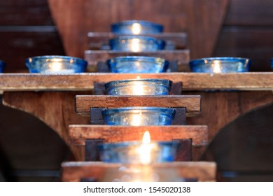 Naju-si, Jeollanam-do / South Korea - OCTOBER 16, 2019:  Candles in a Catholic Church in the shape of a cross - Shutterstock ID 1545020138