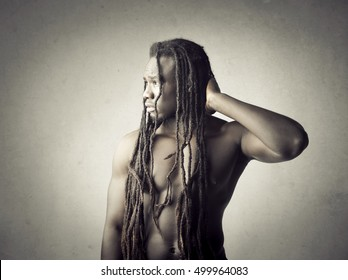 Naked African man with long dreadlocks
