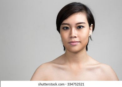 Naked Asian woman with short hair