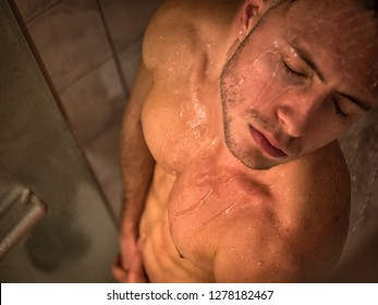 Naked Athletic Young Man Taking Shower in the Bathroom to Refresh, Covering Groin with Hand