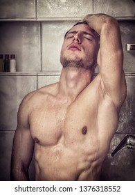 Naked Athletic Young Man Taking Shower in the Bathroom to Refresh