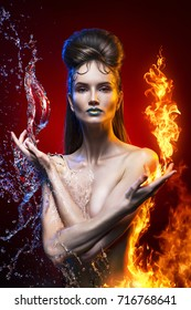 naked beautiful girl topless filled with a fire flames and water splashes on a red background.  vanguard hairstyle. clear healthy skin. vanguard make-up. conceptual art photo