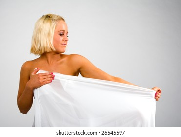 naked blonde and a white fabric