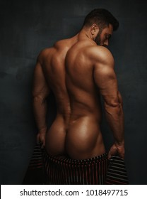 Naked bodybuilder back with towel