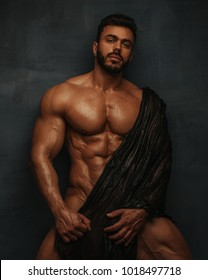 Naked bodybuilder with wet textile