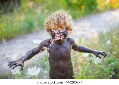 naked boy in the mud