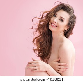 Naked brunette beauty over pink background