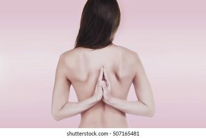 Naked brunette beauty yoga over pink background