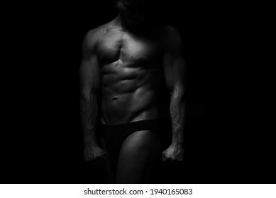 naked chest muscular men in studio