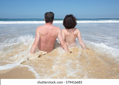 naked couple in the ocean beach in summer vacation