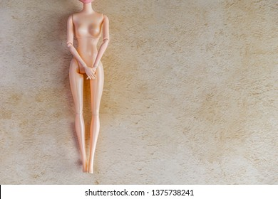 The naked doll covering up perineum