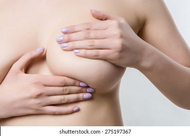 naked female breasts covered with his hands, checking for breast disease, medicine Concept, thrush, cancer
