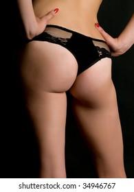 The naked fragment of feminine figure on a black background