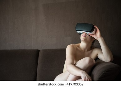 Naked girl in a coach with virtual reality glasses