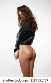 naked girl with curly Hair. nude sexy Beautiful young woman in leather coat