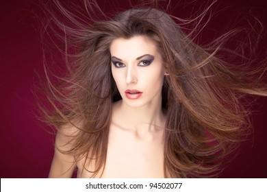 Naked girl with flying long hair, studio shot