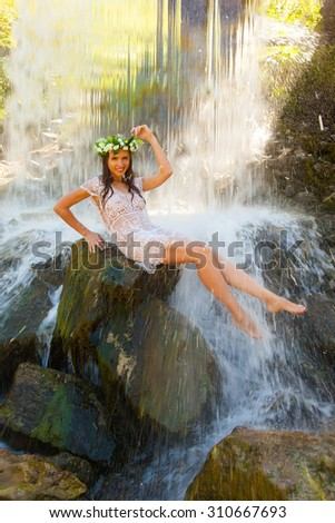 Can naked girl under a waterfall sorry