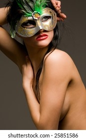 Naked gorgeous brunette with carnival mask portrait