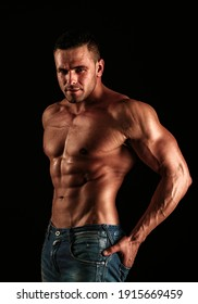 Naked Guy in denim jeans. Nude male torso. Sexy muscular man. Topless muscular fitnes model. Sexy naked body