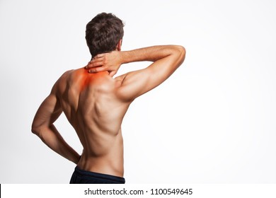 Naked male back torso with hand holding the neck. Neck pain headache.