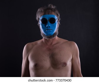naked man in blue mask