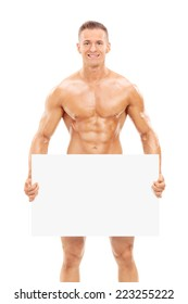 Naked man holding a blank banner in front of his crotch isolated on white background