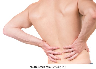 Naked man with lower back pain on white isolated background. Back view. Close-up.