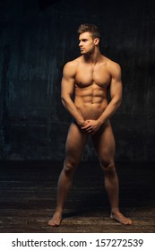 naked man standing sideways