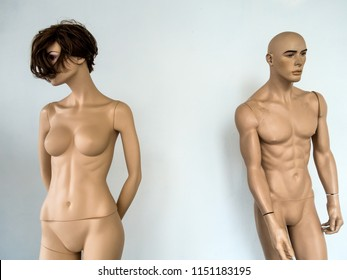naked mannequins in a shop window