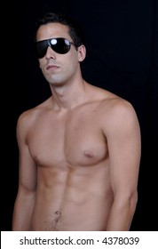 naked muscular male model with sun glasses