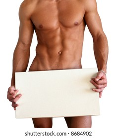 Naked muscular man covering with a box (copy space) isolated on white