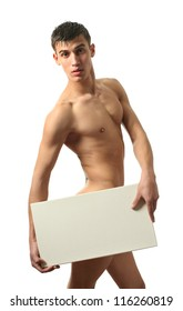 Naked muscular man covering with a copy space blank sign isolated on white