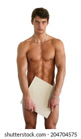 Naked muscular man covering with a copy space white tile isolated on white