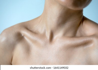 Naked neck shoulders and collarbones of a beautiful woman 35 years old.  People naturally look.  Beauty of the female body. Youthfulness concept.