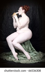 Naked overweight woman eating fresh ripe bananas on black background. Funny image - Fine Art style. Great for calendar