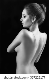 naked sensual woman embraced herself, monochrome