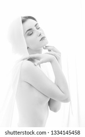 naked sensual woman with veil on white background, cover her body, monochrome