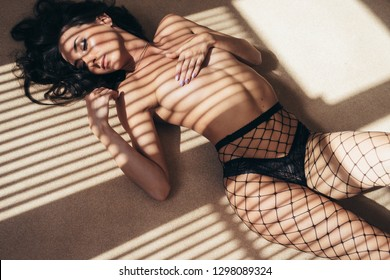 Naked sexy woman lying on the floor. Nude body.