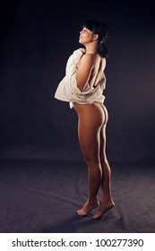 Naked Sexy woman stands in  the studio