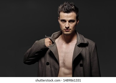 Naked torso handsome young man brown coat gray background cropped view
