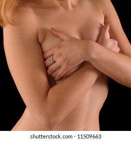 Naked torso of woman's body on black backgrounds