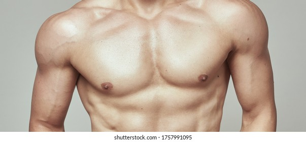 Naked torso of young sportsman man
