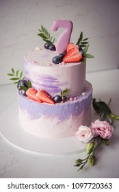 Naked wedding birthday cake. Rustic layer homemade cake with cream. Dessert decorated with chocolate and fruits. Selective focus.
