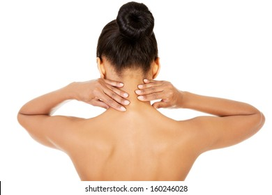 Naked woman doing neck self-examination from the back. Isolated on white.