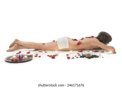Naked Woman Having Spa Treatment With Flower Petals On Her Back
