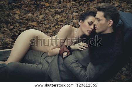 Naked man hugging Woman