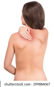 Naked woman with pain in neck on white background. Close-up.