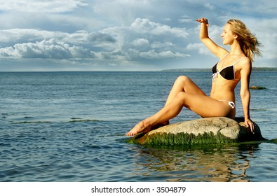 Naked woman relaxing in a light of summer sun